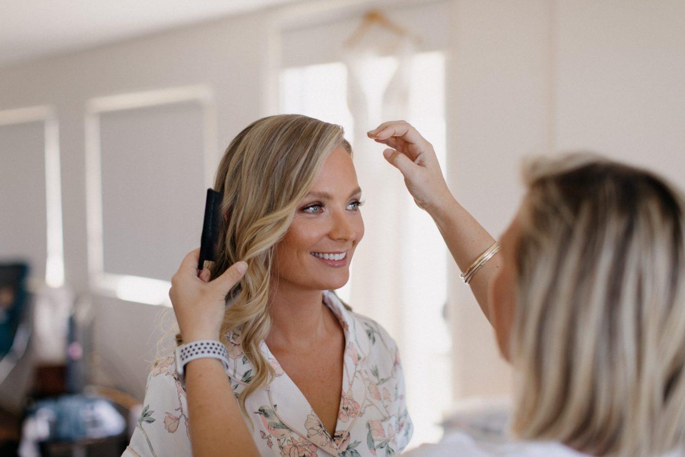 hair stylist doing brides hair